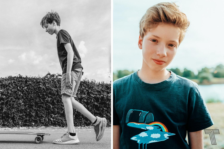 tween boy on longboard / junge auf longboard