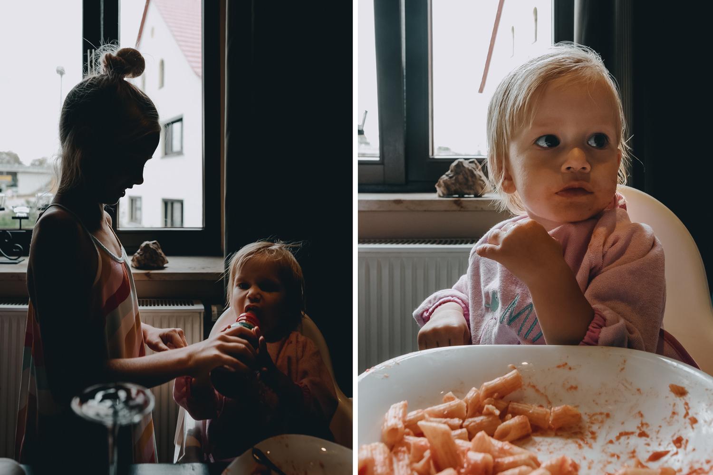 girl feeding baby